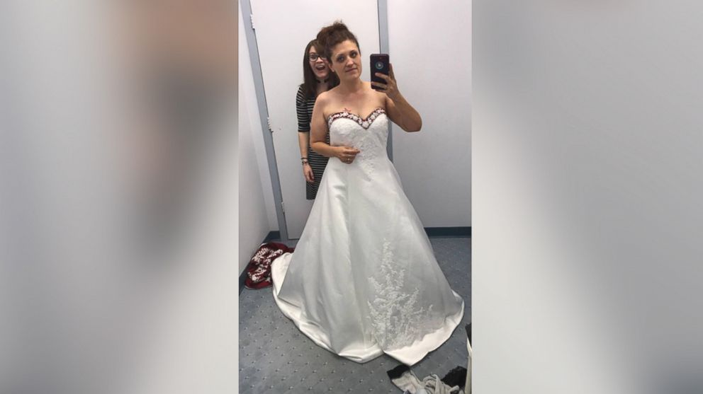 Brooke Ashlock, 35, poses in her vow renewal gown at the Alfred Angelo store in Oklahoma City.