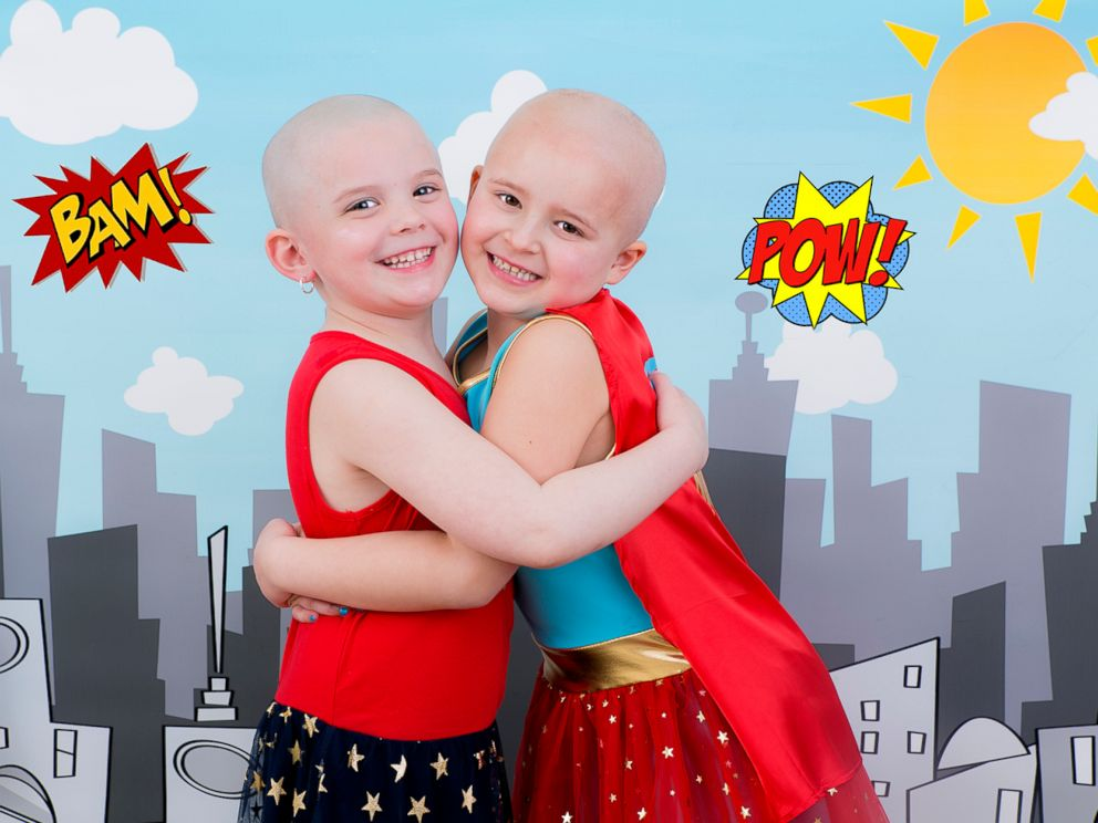 PHOTO: Ella Watters, 6, poses with her friend Emma Zielinski, 5, who shaved her head for her.