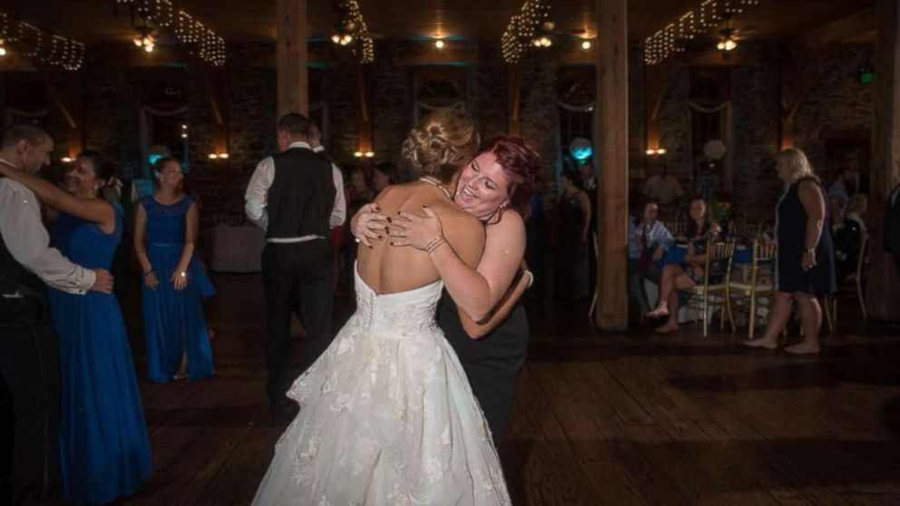 Katie Musser embraces her stepson's mother Casey Bender on her wedding day, September 23, in Pennsylvania.