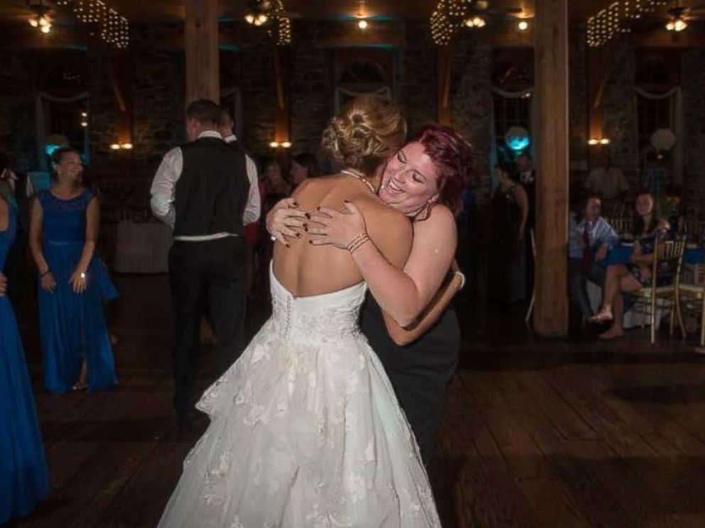 PHOTO: Katie Musser embraces her stepsons mother Casey Bender on her wedding day, September 23, in Pennsylvania.