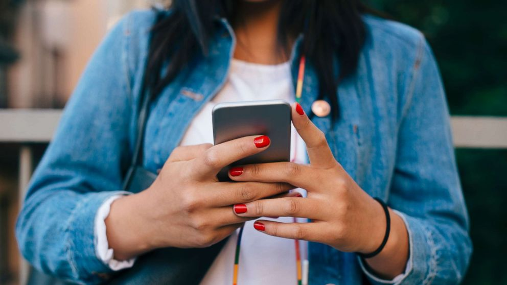 A person uses their cell phone in this undated stock image.