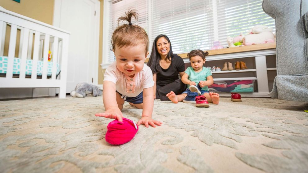 Charnella Grossman, a portfolio manager for Fifth Third, with her daughters, Kenna, 2 and Elise, 11 months.