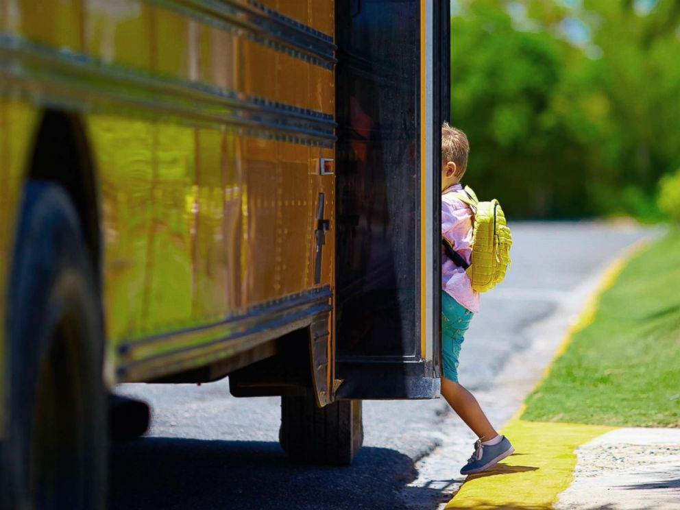 PHOTO: A young boy boards a school bus in an undated stock photo.