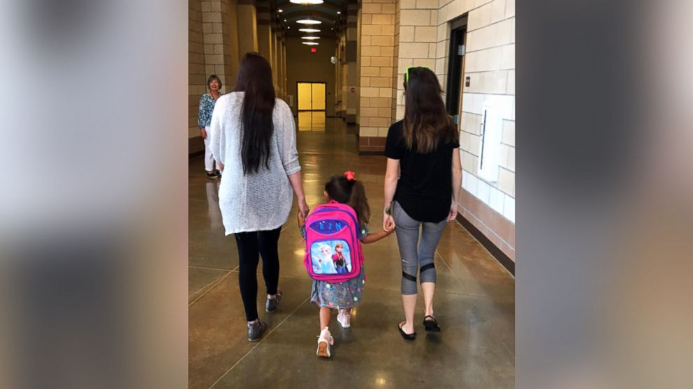 A photo of Haley Booth with her 4-year-old daughter Rachel, and her ex-husband's new girlfriend Dakota Pitman, went viral, inspiring thousands to coparent.