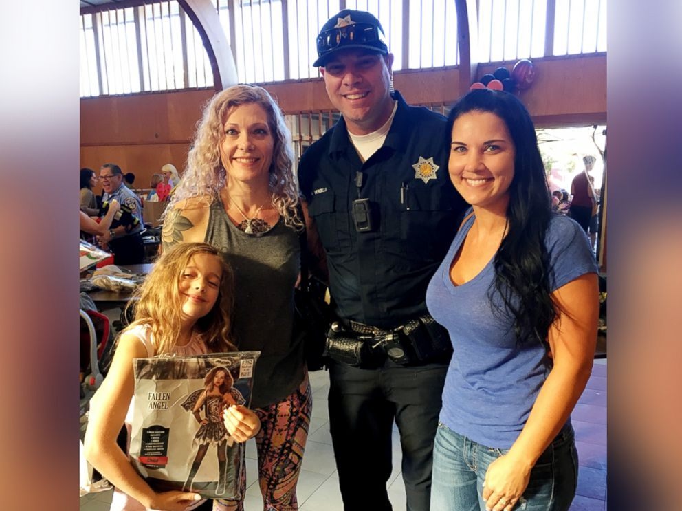 PHOTO: Sascha Humphrey, 9, holds her Halloween costume as she poses with her mother, Colleen Teitgen, left, Santa Rosa Polcie Officer Nick Vercelli and his fiance.