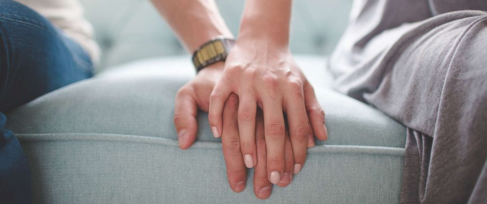 PHOTO: A couple holding hands in an undated stock photo.