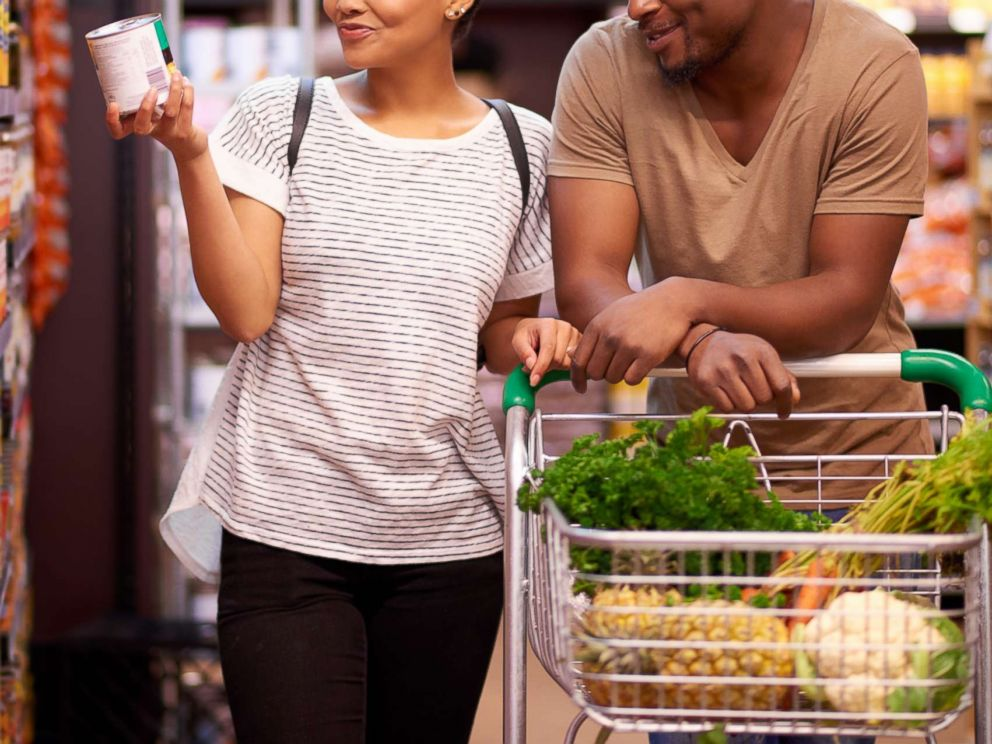 PHOTO: A young couple shop in a grocery store in an undated stock photo.