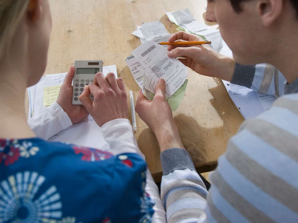 PHOTO: A couple looks over their finances.