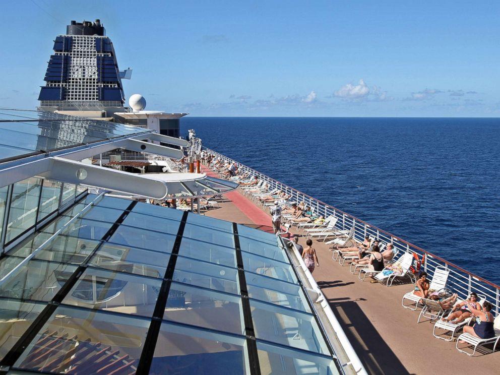 PHOTO: Passengers sunbathe aboard Celebrity Cruises Inc.s Constellation in the Caribbean Sea near the coast of Cuba on Sunday, Dec. 16, 2012.