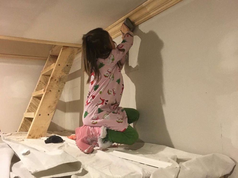 PHOTO: Michigan dad Adam Boyd built his daughters an amazing two-story playhouse with porches, a rock wall and 8-foot ceilings.