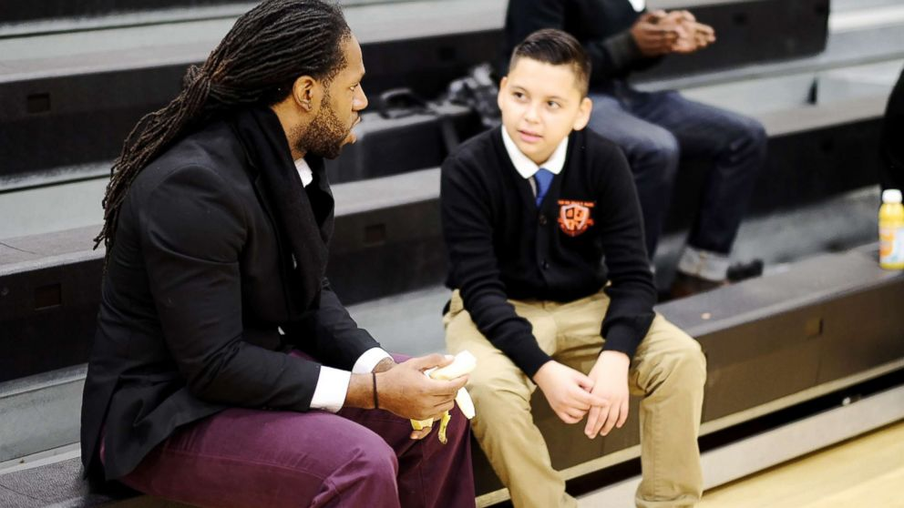 """A mentor and a student talk during Billy Earl Dade Middle School's """"Breakfast with Dads"""" event on Dec. 14, 2017."""