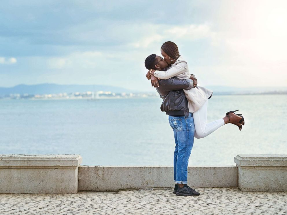 PHOTO: A man lifts a woman while embracing her in an undated stock photo.