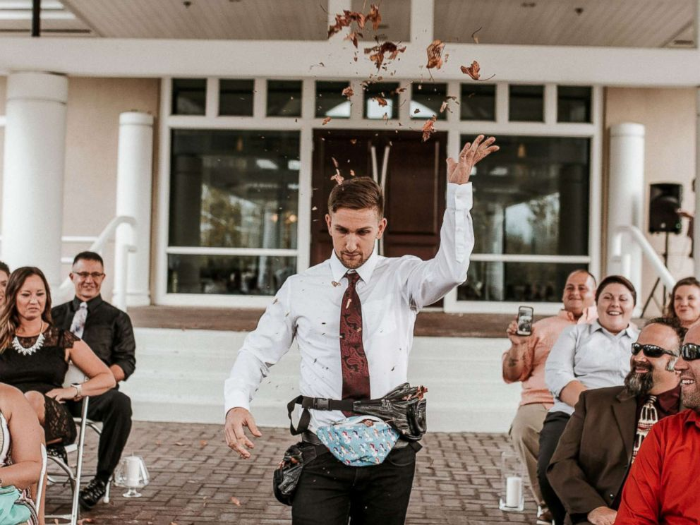 PHOTO: Jake Clark of Dayton, Ohio, served as his friends flower man, throwing fall foliage out of fanny packs on Oct. 7.