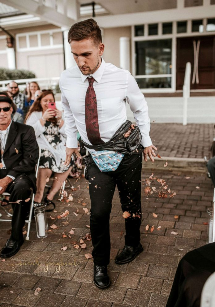 PHOTO: Jake Clark stole the show as the flower man as he strutted down the aisle at his friends wedding.