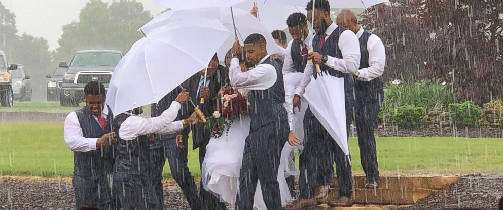 A Bride Is Protected From Pouring Rain Thanks To Groomsmen Abc News