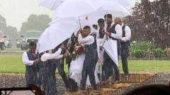 PHOTO: Diana Joseph was protected from rain on her wedding day, May 20, 2018, thanks to her husband Marcus groomsmen.
