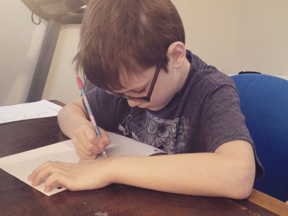 PHOTO: Beckett Dillon studies in his familys home in this 2015 photo.
