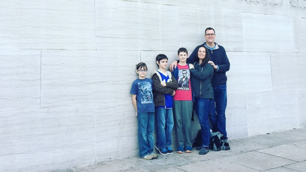 Dan and Anne Dillon pose with their three sons on a family trip to Washington, D.C.