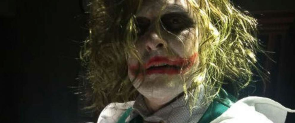 PHOTO: Dr. Paul Locus, dressed as The Joker, delivers Oaklyn Selph inside Henry County Medical Center in Paris, Tenn.