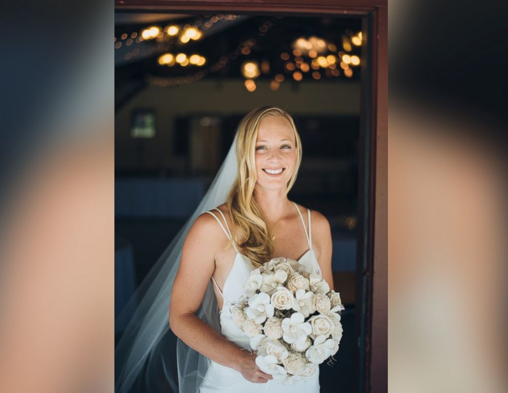 PHOTO: Enie Hensel shows off her eco-friendly bridal bouquet, made of sola flowers.