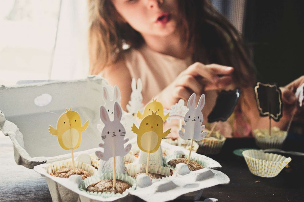 PHOTO: A girl decorates muffins for Easter in an undated stock photo.