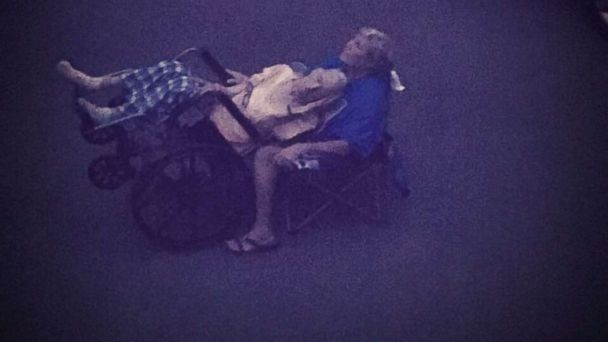 Photo of woman helping her elderly father experience the eclipse is pulling heartstrings