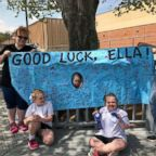 Ella Chambers, bottom right, with the sign made for her by her schoolmates at Hazel Grove Elementary.