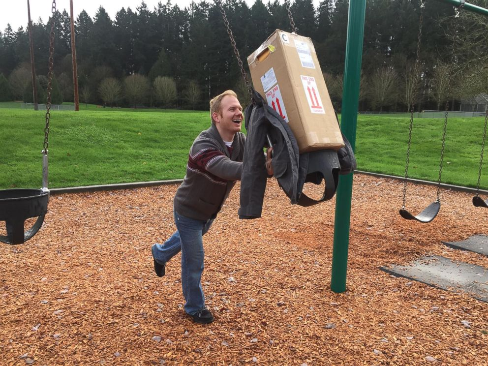 PHOTO: Mickey Clark of Oregon pretends to swing the box containing frozen embryos in a posed photo taken in 2016.