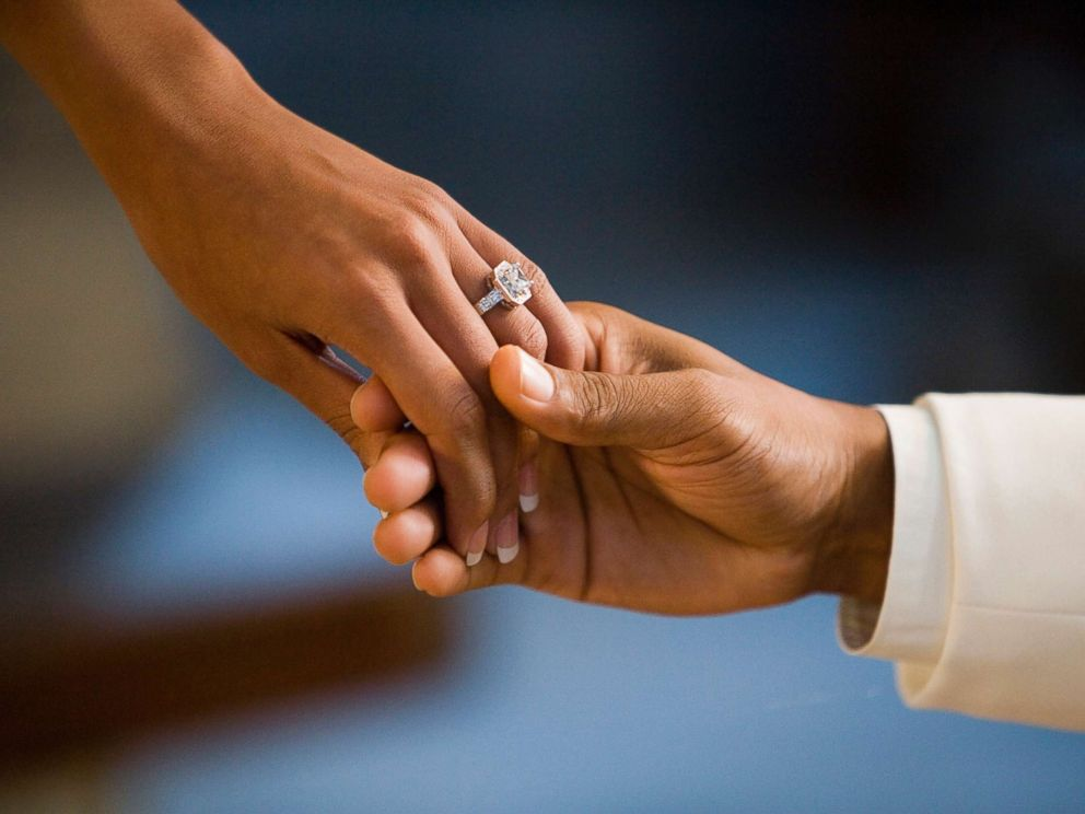 PHOTO: A man and woman hold hands showing off a large diamond ring in this undated stock photo.