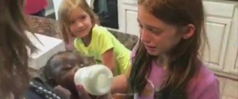 PHOTO: Raygen Pruitt, 11, and Harper Pruitt, 6, met their newly adopted sister in a surprise that was captured on video.