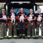 The firefighters of Glenpool Fire Department in Glenpool, Okla., pose with their babies on Sunday, May 20, 2018.