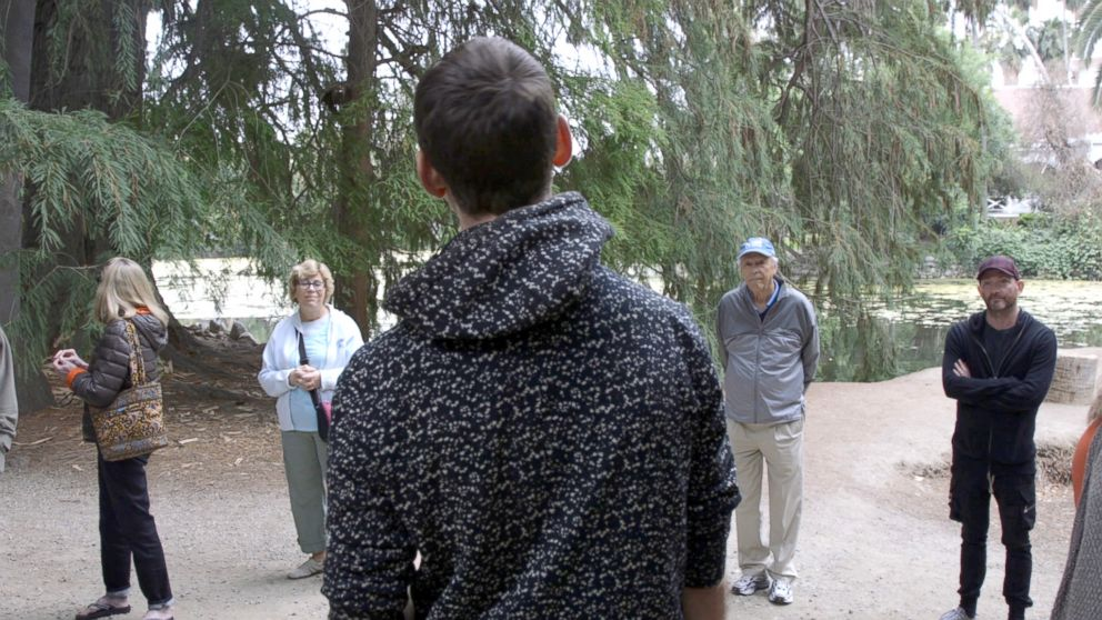 PHOTO: Participants listen to Ben Page at a forest therapy session at the Los Angeles County Arboretum and Botanic Garden.