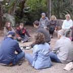 Forest bathing participants sit at the Los Angeles County Arboretum and Botanic Garden.
