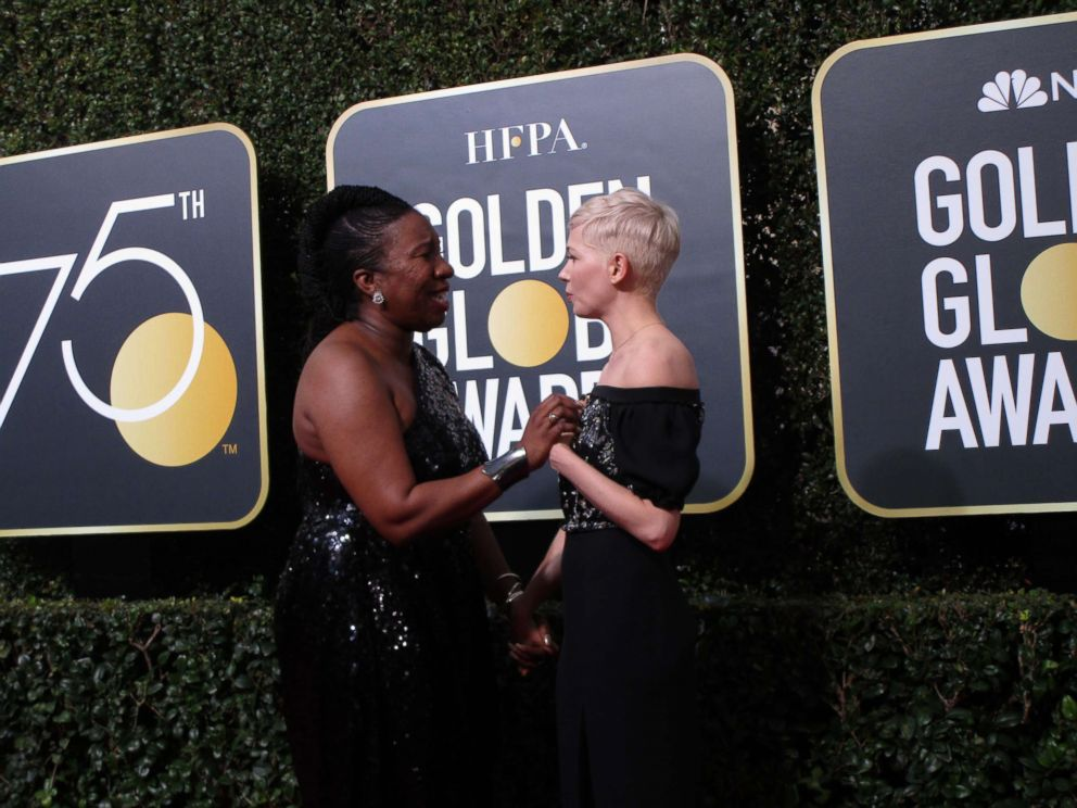 PHOTO: Francine Gascon, 10, photographed a moment between actress Michelle Williams and Me Too founder Tarana Burke on the Golden Globes red carpet.