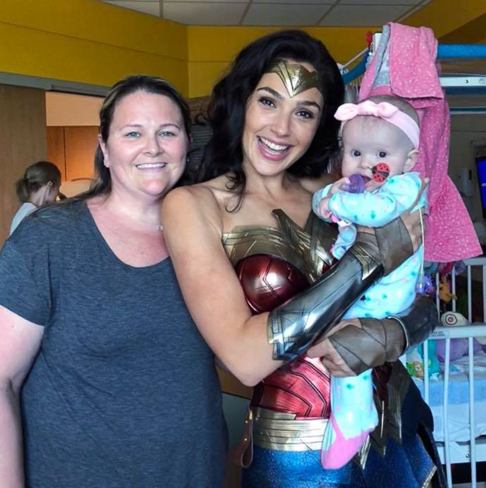 PHOTO: Actress Gal Gadot poses for a photo with Kelly Swink Sahady while holding 7-month-old Karalyne Sahady, who is being treated for acute myeloid leukemia, at Inova Childrens Hospital in Falls Church, Va., July 6, 2018.