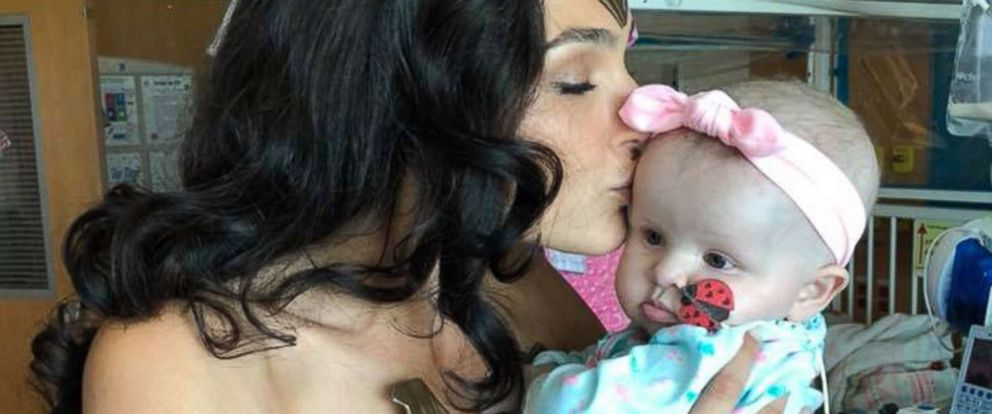 PHOTO: Actress Gal Gadot kisses 7-month-old Karalyne Sahady, who is being treated for acute myeloid leukemia, at Inova Childrens Hospital in Falls Church, Va., July 6, 2018.