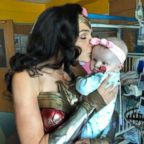 Actress Gal Gadot kisses 7-month-old Karalyne Sahady, who is being treated for acute myeloid leukemia, at Inova Children's Hospital in Falls Church, Va., July 6, 2018.