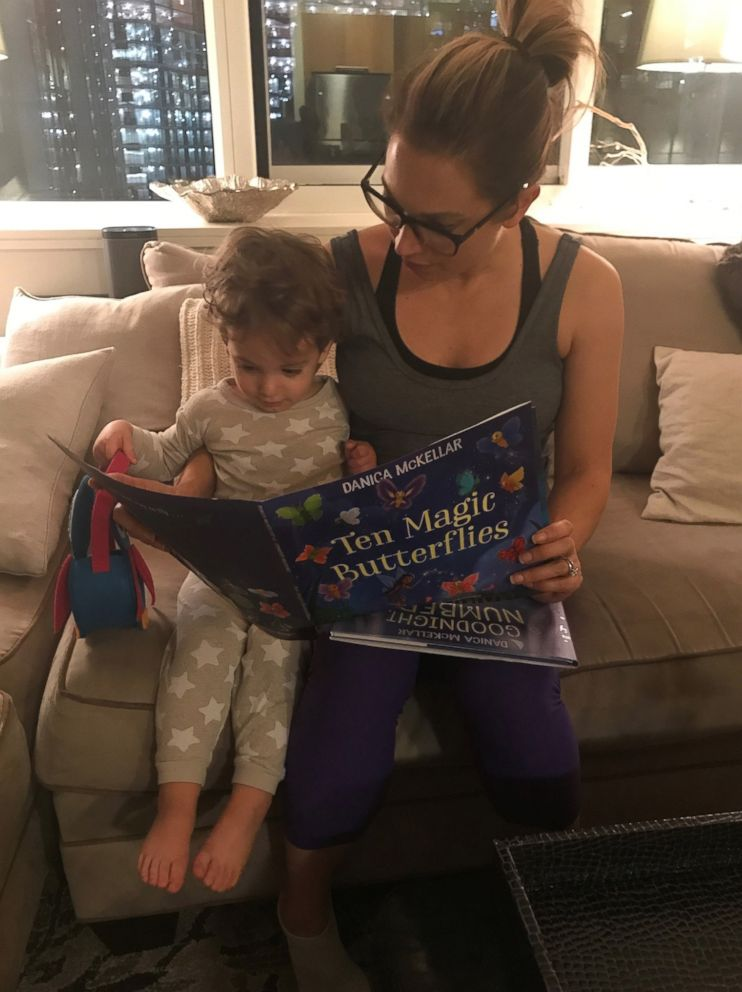 PHOTO: ABC News chief meteorologist Ginger Zee reads to her son, Adrian.