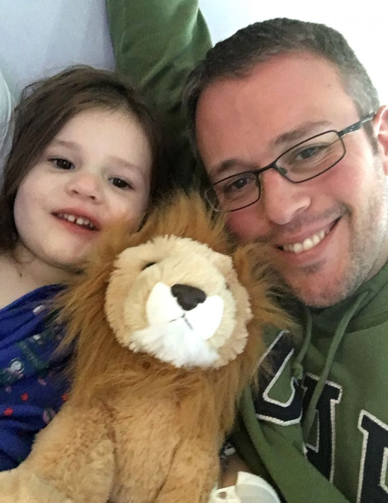 PHOTO: Lena with her dad Matt Tietjen holding a stuffed lion that symbolizes her strength.