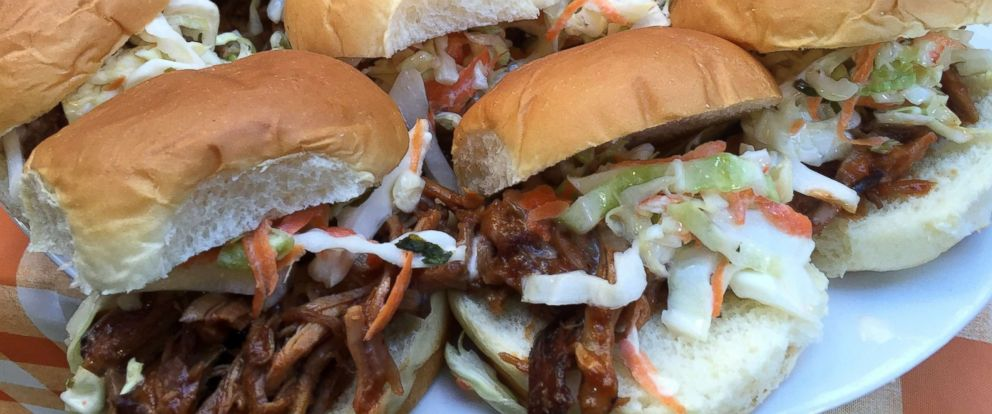 Food network chefs top memorial day weekend bbq party tips and photo slow cooked pork shoulder sandwich forumfinder Gallery