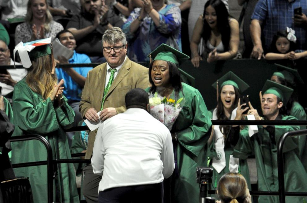 PHOTO: Joshua Okpara proposed to Charmecia Goree at University of North Texas May 11, 2018 graduation.
