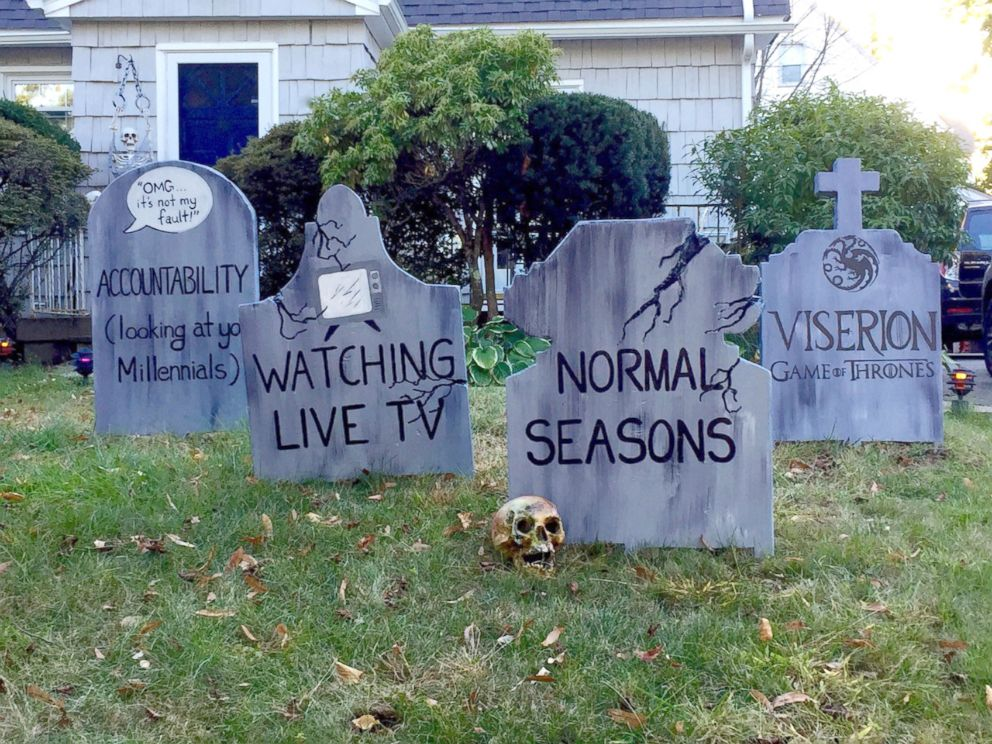 PHOTO: The art teachers gravestones paid homage to normal seasons and watching live tv.