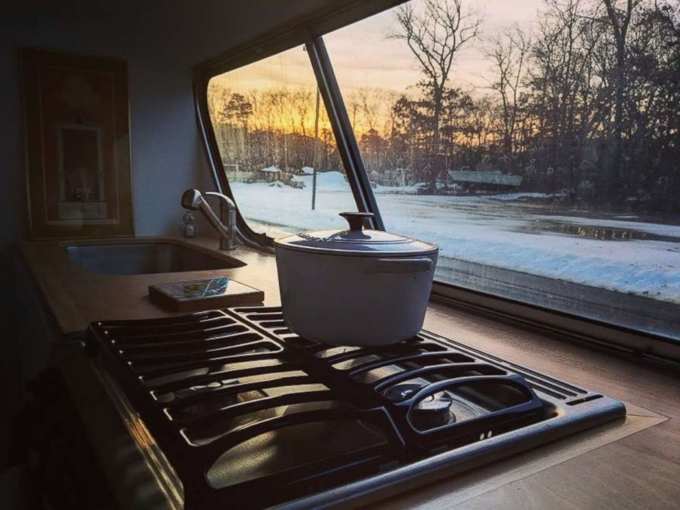 The stove inside Jessie Lipskin's converted RV offers scenic views.