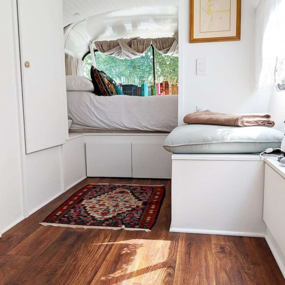 Jessie Lipskin's converted RV includes a cozy bed and space for books.