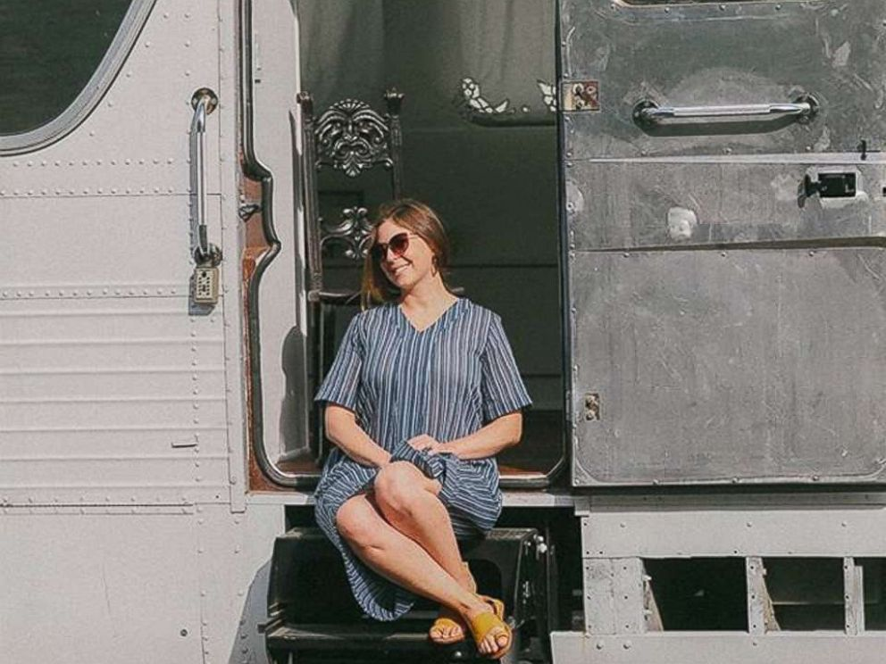 PHOTO: Jessie Lipskin sits on the steps of the chic RV she converted from a Greyhound bus.