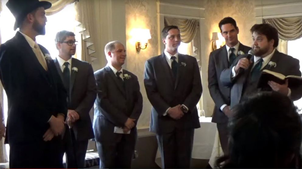 """PHOTO: Adam Lauver has wedding guests cracking up over his dramatic reading of Rick Astleys """"Never Gonna Give You Up."""""""