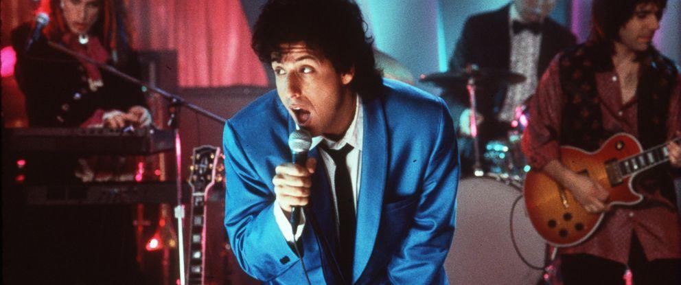 PHOTO: Adam Sandler sings in a scene from the film The Wedding Singer, 1998.
