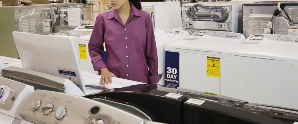 PHOTO: A woman viewing washing machines in appliance showroom in this undated stock photo.