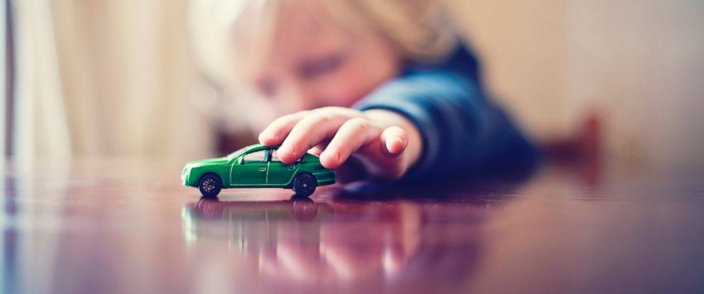 PHOTO: An undated stock photo shows a young boy playing with a toy car.