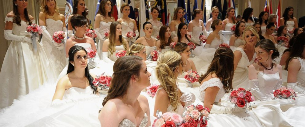 PHOTO: Debutantes pose for a photo during the 60th International Debutante Ball at The Waldorf Astoria on Dec. 29, 2014 in New York City.
